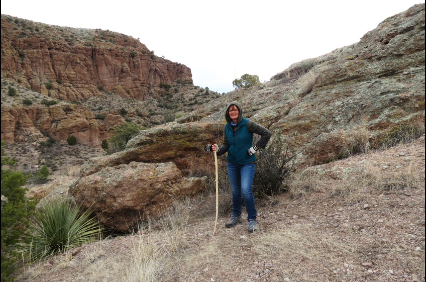 A recent hiker explores the cliffs above Bear Creek at New Mexico Cabin Rentals in Gila NM