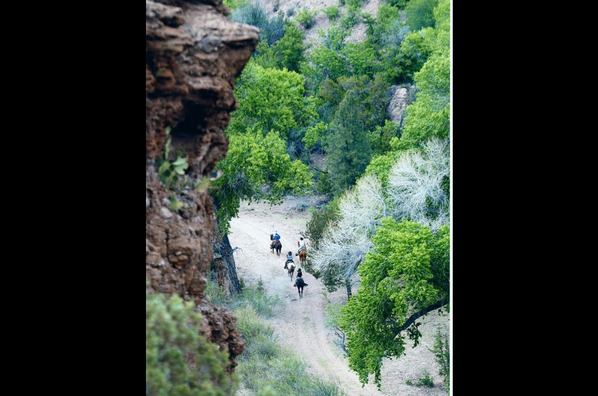 Horseback Riders Explore Canyon at New Mexico Cabin Rentals