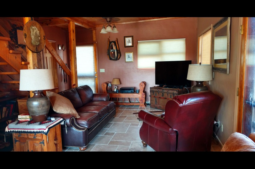 Comfortably furnished living room at Bear Creek Canyon Retreat - New Mexico Cabin Rentals