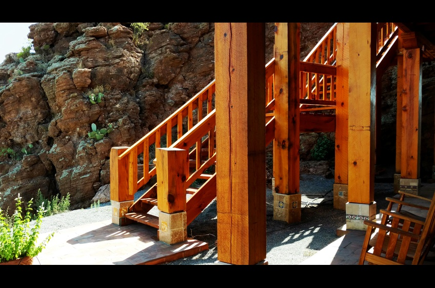 The exterior stairway leads to a large, wrap-around deck facing west, north and east.  Stunning vistas at Bear Creek Canyon Retreat - New Mexico Cabin Rentals.