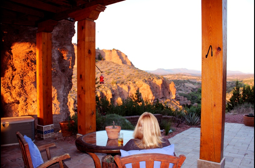 Nearing sunset, the hummingbirds join you at Bear Creek Canyon Retreat, New Mexico Cabin Rentals.